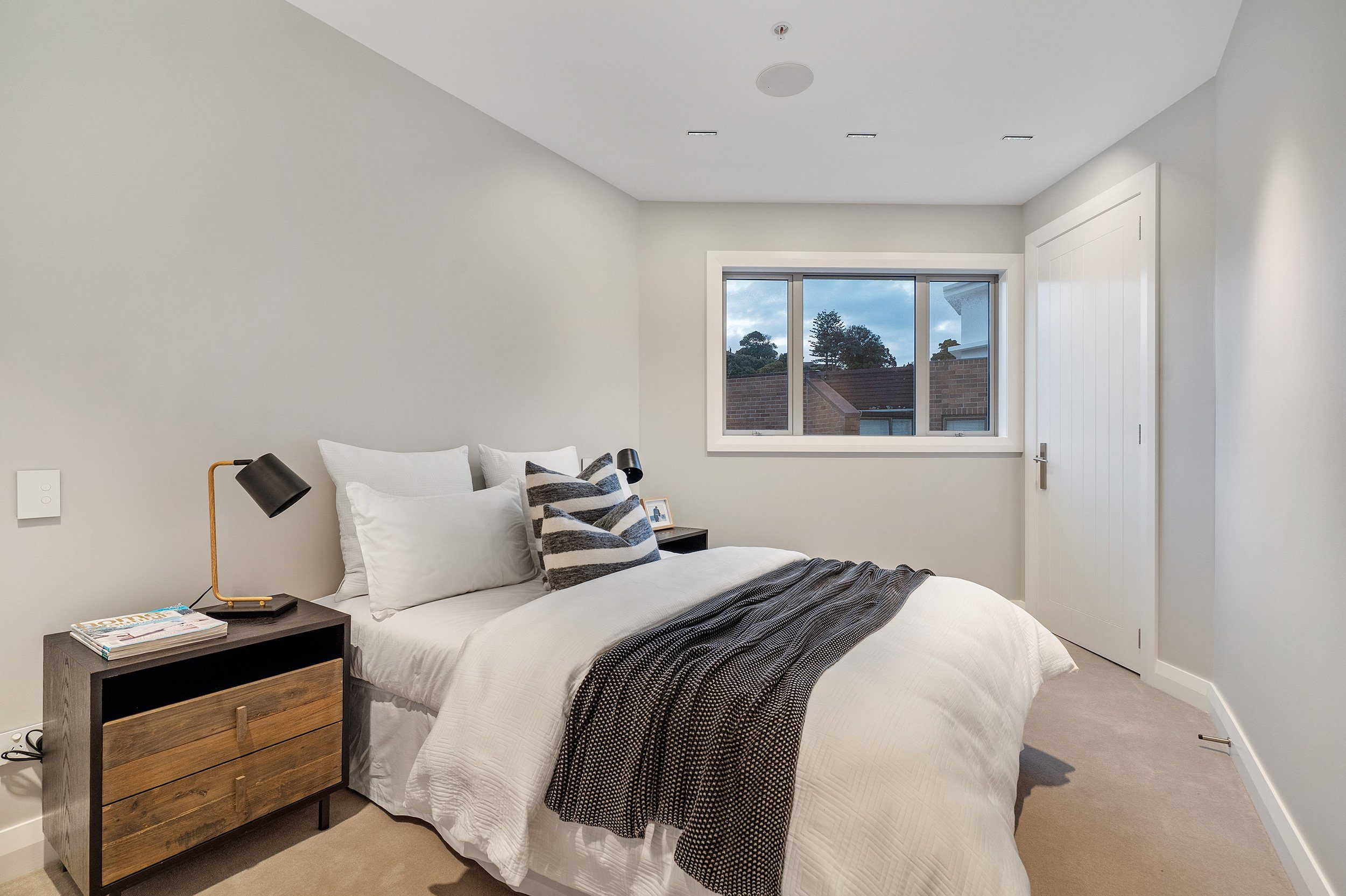 Bedroom with black and white throw