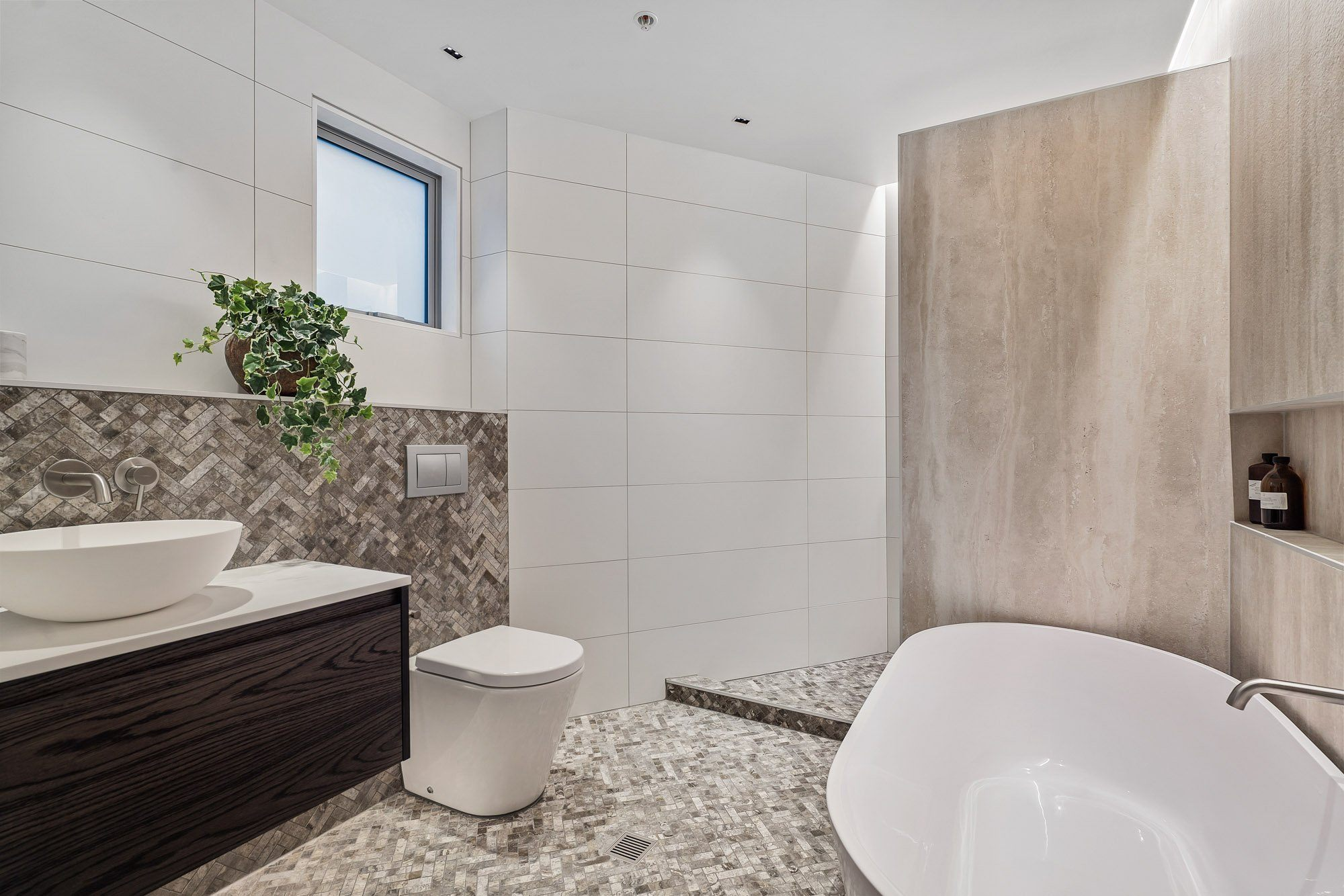 Bathroom with tiles floor and bathtub
