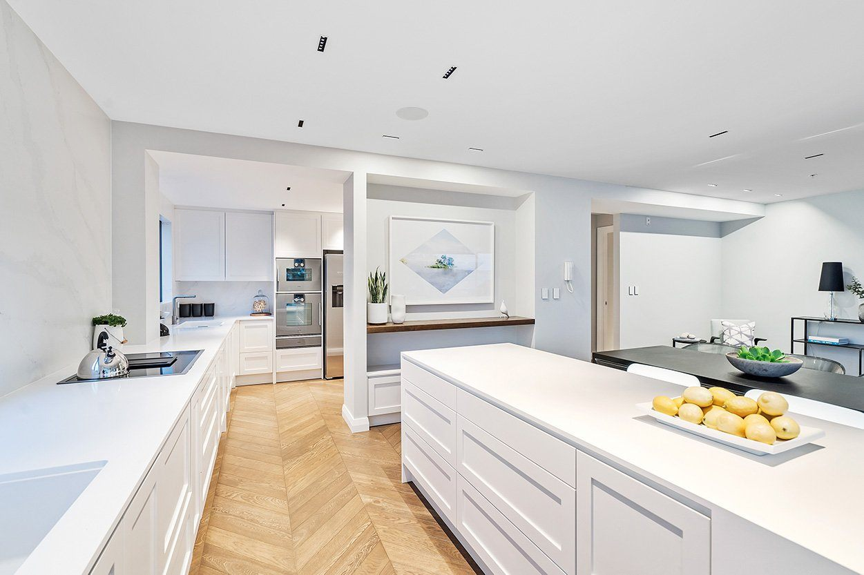 White kitchen with lemons on benchtop