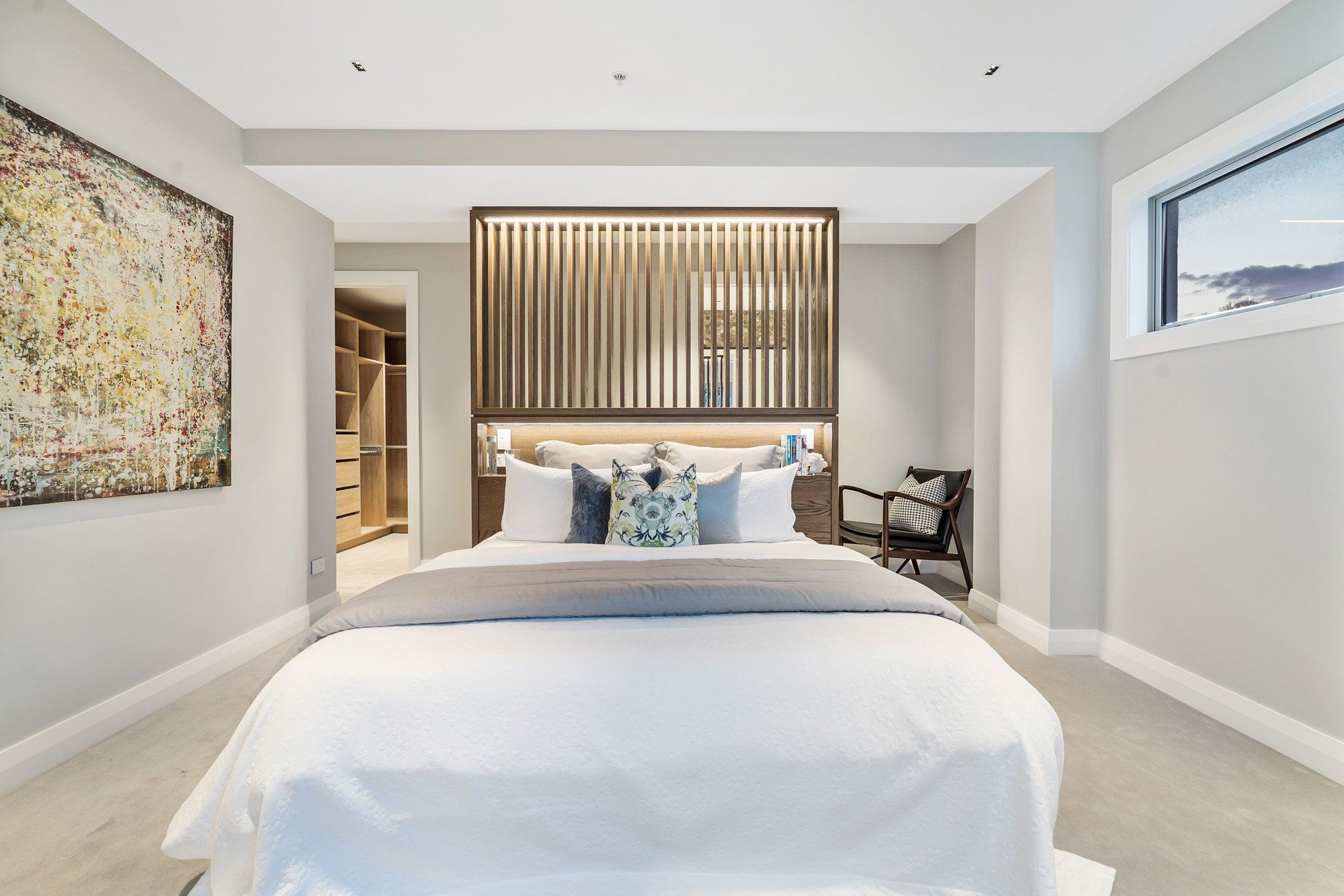 Bedroom with white duvet and cushions